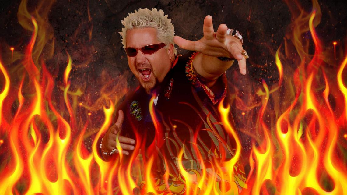 Guy Fieri wearing an extremely awful shirt